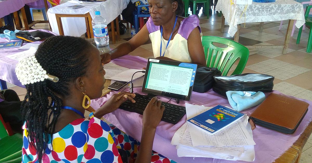Bible Translators using Computer Tablets for National Translator