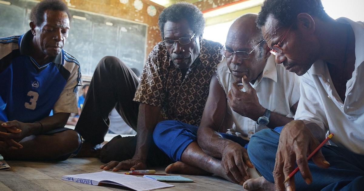 National Bible Translastors studying Bible stories