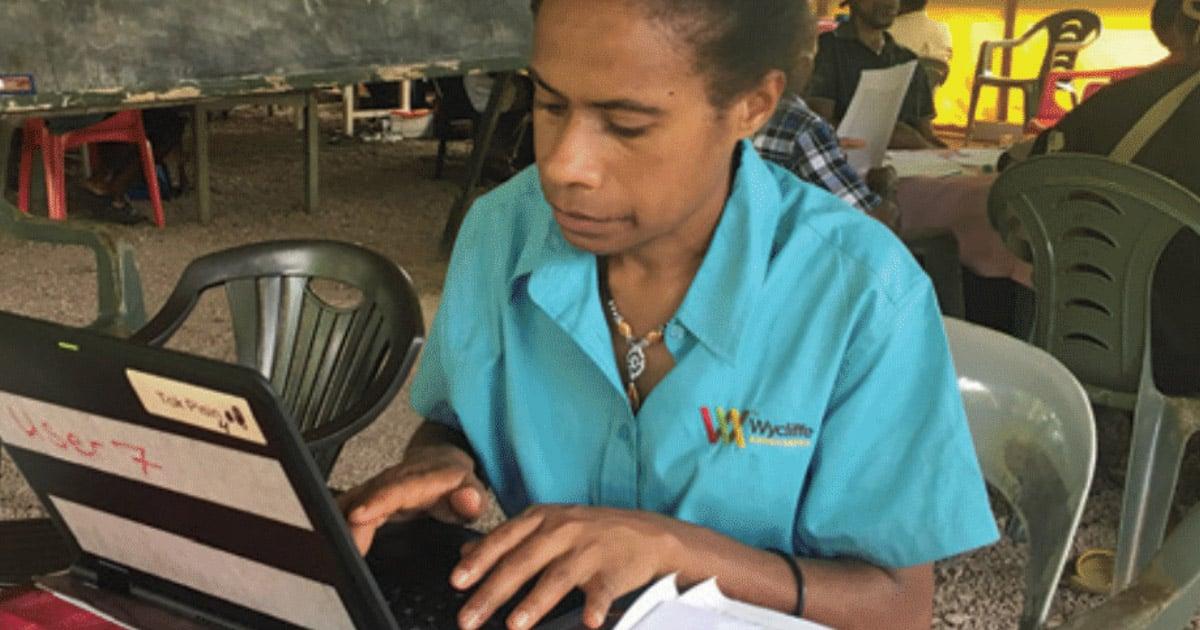 Dedicated translator Shilla working on a laptop