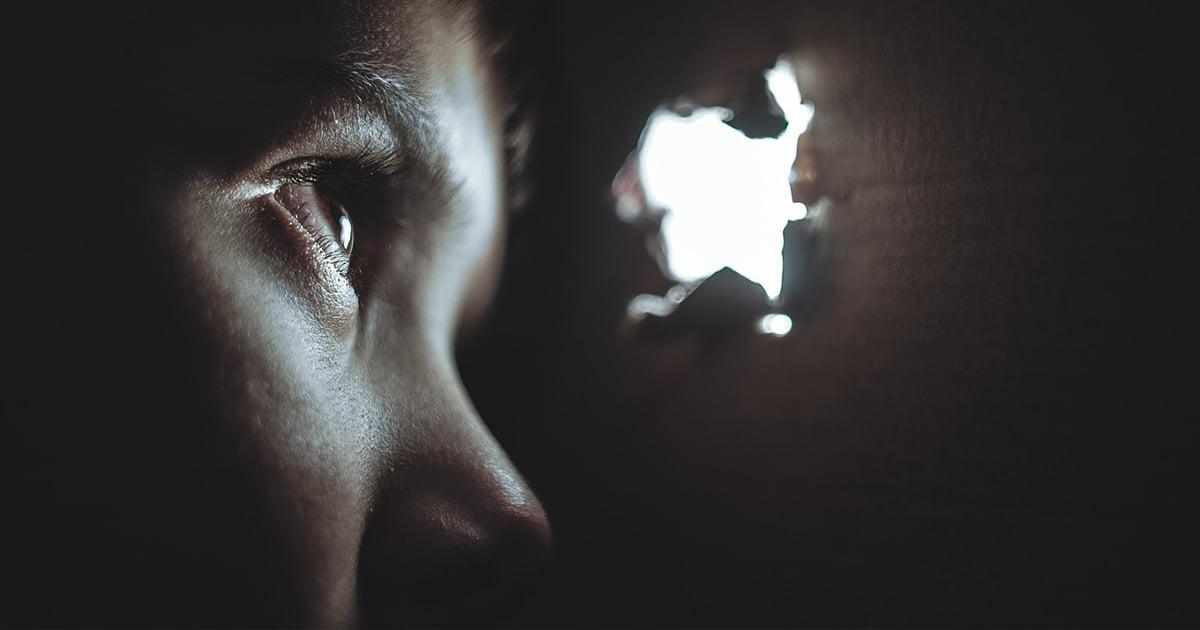 A person hidden behind a wall