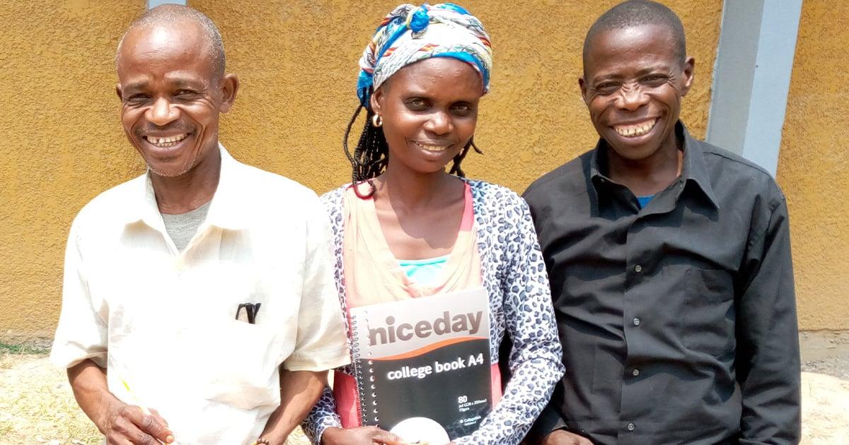 Three smiling Bible translators