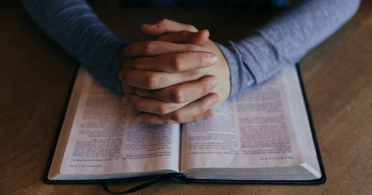 Praying Hands on Bible | Wycliffe Associates | Prayer Request