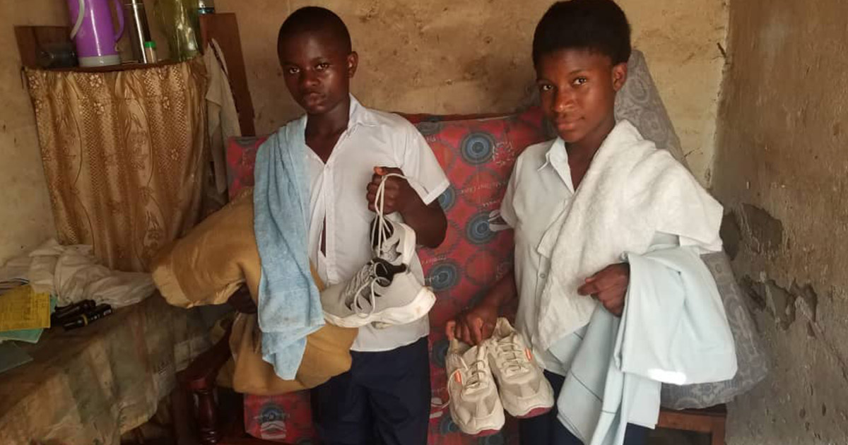 Students with their clothing and bedding