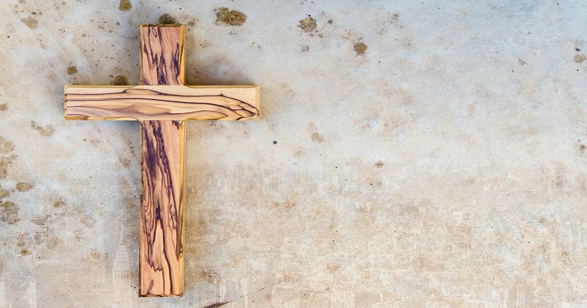 Wood Cross on Marble Wall