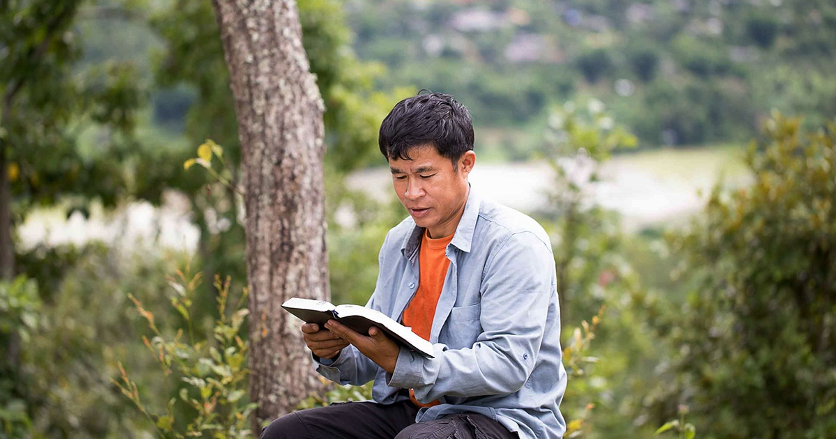 asian man reading bible - 1200.jpg