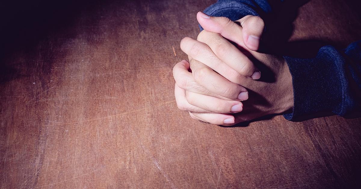 young man praying | Wycliffe Associates | Accelerating Bible Translation