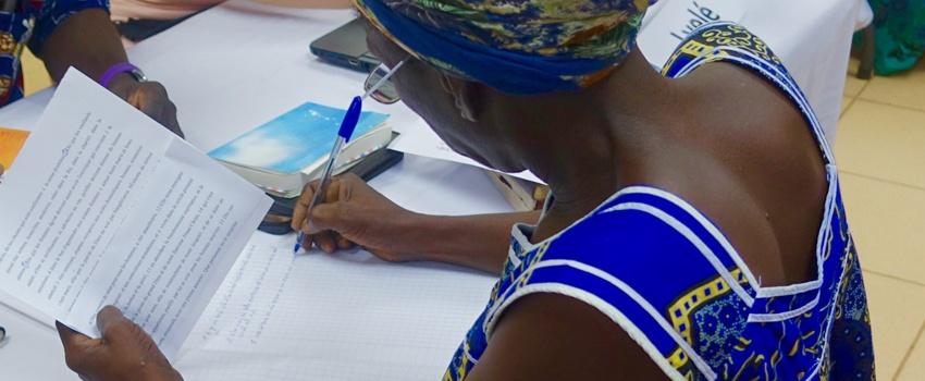 National Bible translator writing   MAST   Accelerating Bible Translation