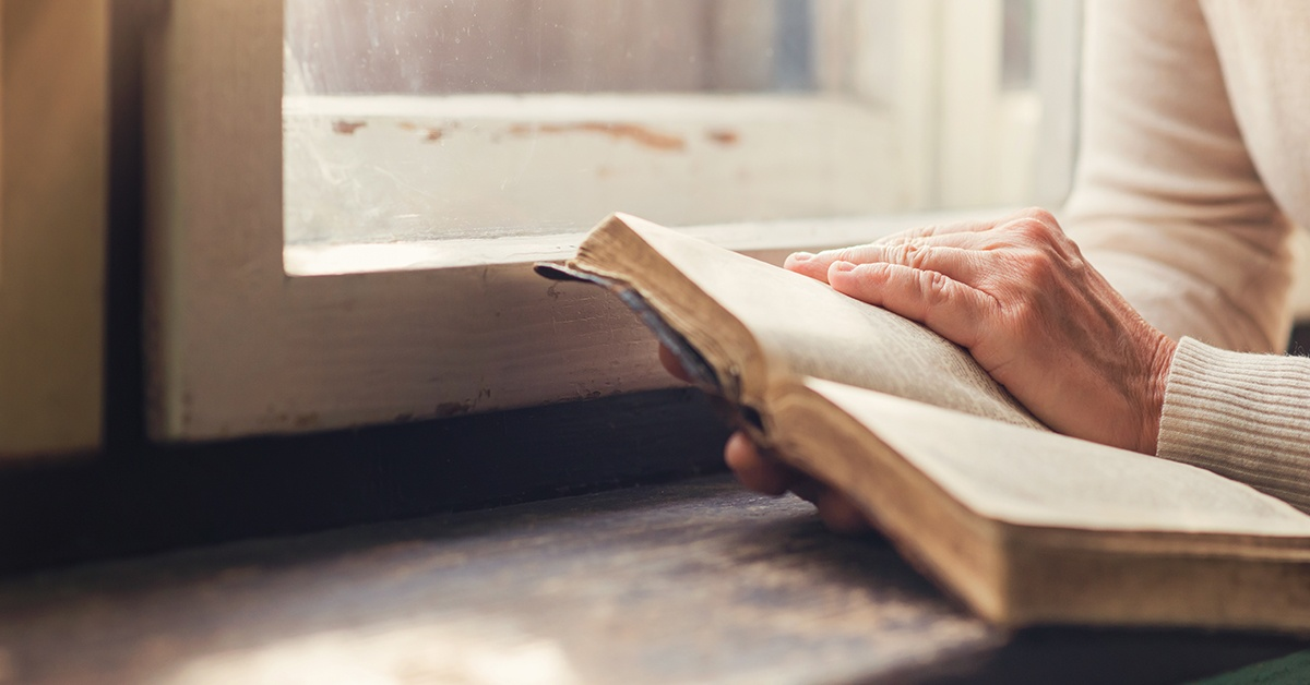 Bible in hands | Accelerating Bible Translation