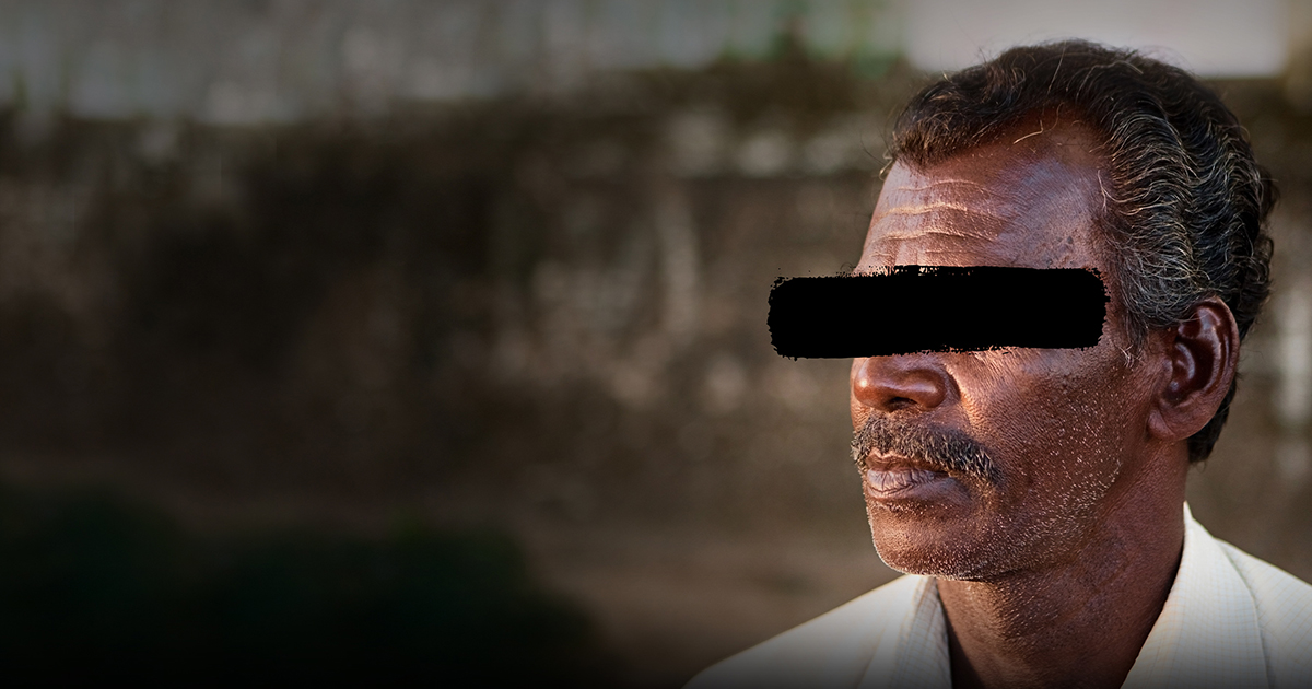 Man_with_black_mark_across _face | Wycliffe Associates Pray for Persecuted Believers