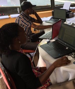 Bible translators working at computers