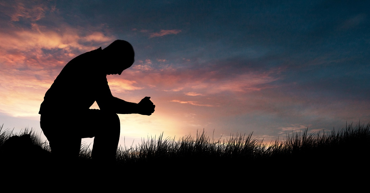 man-praying-in-the-grassy-field_blog 1200 x 628.jpg