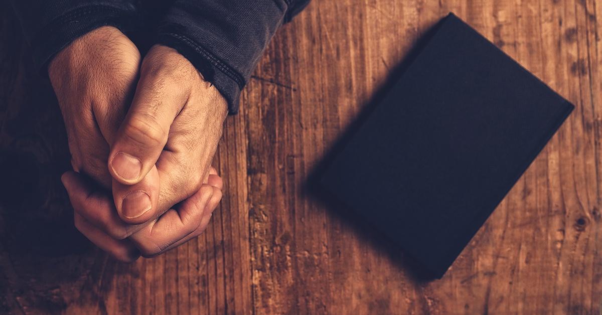 man_praying_with_Bible_-_1200x628